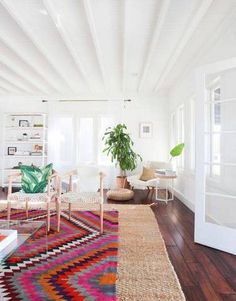 Layered under a smaller bright and graphic rug, this sisal rug is a great way to mix textures.