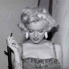 Marilyn at the St. Jude's Children's Hospital charity event at the Hollywood Bowl. Photo by Bruno Bernard, July 10th 1953.