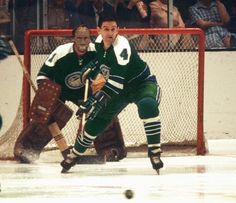 Defenceman Wayne Muloin, Charlie Hodge in net for the Oakland Seals.