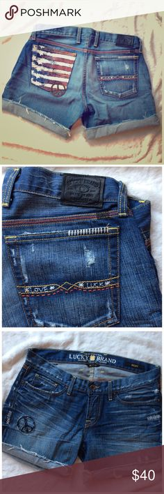 """LUCKY BRAND FLAG SHORTS Peace symbols and embroidery.  Excellent. Only worn a time or two. 8"""" rise 6"""" inseam rolled down.  All cotton Lucky Brand Shorts Jean Shorts"""