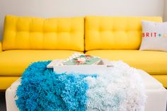 A Pom Pom Rug, Wall Hanging and Table Cover in One! via Brit + Co