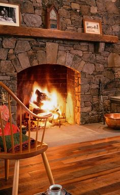 floor-level stone fireplace, wooden mantle