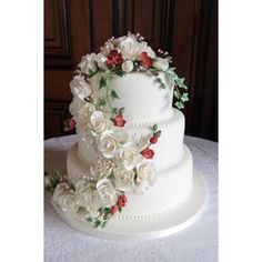 Wedding Cake decorated with a cascading bouquet of hand crafted sugar flowers.