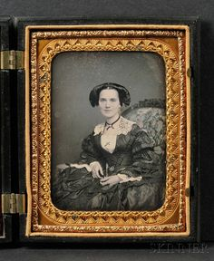 "Quarter Plate Daguerreotype Portrait of an Elegantly Dressed Young Woman, wearing and elaborate hairstyle, with tinted flowers on chair upholstery, in a black ""Scroll"" (Krainik 66) Union case, (minor scratches u.r., tarnish l.r.)."