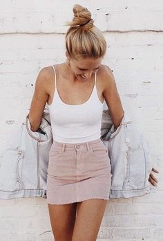 White singlet, denim jacket, pink skirt. Casual outfit inspiration.