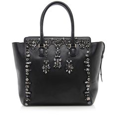 A collectible Valentino tote in exquisite black lambskin with radiant crystal details and silver-tone hardware. Features include two rolled handles, a zip closure, and fully lined interior with two open and one zip pocket.