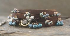 Studio Blue new item: Leather Wrap Bracelets (single and double wrap) in black pearls. Also shown with our Roman Coin/Leather Brace...