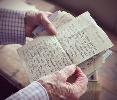 """letters: my grandmother's hands holding letters from her own grandmother sent during WWII"""