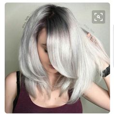 Icy blonde with dark roots More
