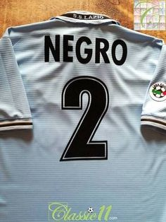Official Puma Lazio home football shirt from the season. Complete with Negro on the back of the shirt in original lettering, and Serie A patch on the sleeve. Bologna Fc, Genoa Cfc, Uefa Super Cup, Classic Football Shirts, Nfl Jerseys, Uefa Champions League, Lettering, Numbers, Sleeves
