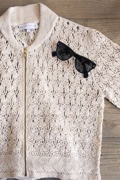 Nellie Partow Talks Her Spring 2017 Collection and Boxing: Crochet White Zip Up Sweater with Black Sunglasses   coveteur.com