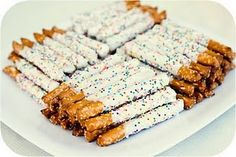 Cute way to display Pretzel rods dipped in white chocolate and sprinkles