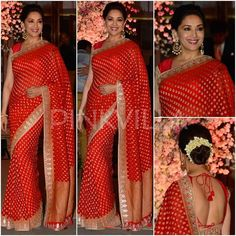 For a wedding reception last night, Madhuri Dixit wore a traditional red saree by Anita Dongre.Her pretty saree with gota work border was styled with. Indian Bridal Wear, Indian Wear, Bridal Lehenga, Saree Wedding, Wedding Wear, Bollywood Saree, Bollywood Fashion, Indian Dresses, Indian Outfits