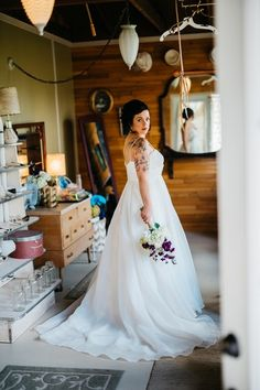 Spaghetti strap tulle ball gown wedding dress {Apaige Photography}
