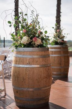 Wine barrel floral arrangements for wedding