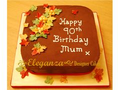 90th birthday cake coated with chocolate ganache and maple leaves
