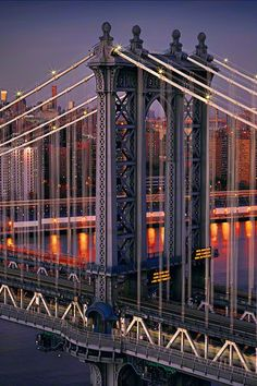 The Manhattan Bridge is a suspension bridge that crosses the East River in New York City, connecting Lower Manhattan (at Canal Street) with Brooklyn (at Flatbush Avenue Extension)  Construction: 1901-1912  Total length	6,855 ft (2,089 m)  Width	120 feet (37 m)  Height	336 ft (102 m) (towers)  Longest span	1,480 feet (451 m)  Constructed by	: Othniel Foster Nichols