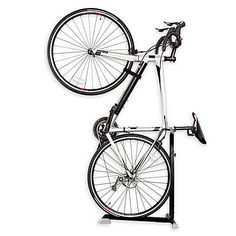 Store your bike indoors on this convenient Bike Nook Bike Stand. This sturdy steel stand has an adjustable height suitable for most bikes with wheels and larger and it keeps bikes standing in an upright position to save floor space. Mountain Bike Shoes, Mountain Bicycle, Mountain Biking, Bicycle Stand, Vertical Bike Stand, Bicycle Rack, Bike Stands, Design Logo, Road Bike Women
