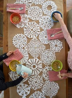 turn paper snowflakes into a table runner