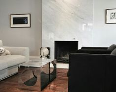 Gorgeous Carrera Marble trend Toronto Modern Living Room Inspiration with clean flooring furniture grey marble fireplace minimal paint Stone fireplace Bedroom Fireplace, Fireplace Mantle, Living Room With Fireplace, Fireplace Design, Fireplace Ideas, Painted Stone Fireplace, Marble Fireplaces, Living Room Modern, Living Spaces