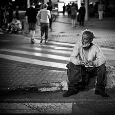 May 6th 2015/Skopje, Macedonia: Homeless Man is watching the protestors shouting towards the policemen that are guarding the Assembly of Republic of Macedonia.