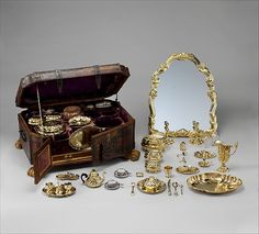 Toilet set in original leather case Fourteen identified German (Augsburg) goldsmiths and other German artisans; Japanese (Imari) porcelain maker Date: ca. 1743–45 Medium: Gilt silver, hard-paste porcelain, cut glass, walnut, carved and partially gilt coniferous wood, blind-tooled and partially gilt leather, partially gilt steel and iron, textiles, moiré paper, hog's bristleJapanese (Imari) porcelain maker | Toilet set in original leather case | German, Augsburg | The Met
