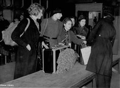 Photograph: Jewish refugees arriving at customs in Great Britain, 1938.