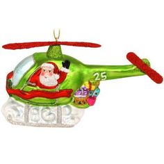 Santa In Helicopter Glass Ornament from Bronner's Christmas store of Christmas ornaments and Christmas lights Christmas Store, Santa Christmas, Christmas Lights, Xmas, Santa Ornaments, Glass Ornaments, Holidays And Events, Candy Cane, Reindeer