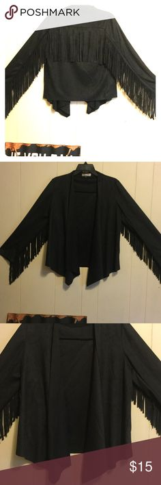 "Black Fringe Suede Open Jacket An awesome buttery soft, Suede Jacket, open in the front with fringe running across the arms and the back. Shoulders measure 16"", sleeves 23 1/2"", length in front is 28"" at longest point, and 24"" in back. Fringe on right sleeve has some fuzz issues, nothing too noticeable. See picture. NWOT Karen T Designs Jackets & Coats"