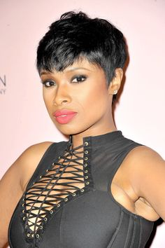 Jennifer Hudson's pixie cut was tousled for an edgy rockstar style at the New York Stock Exchange celebration, and she paired it with a neon, coral lip color.