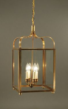 6732 Northeast Lantern Crown Outdoor Hanging Lantern - The Crown 6732 (pictured in antique brass and clear glass) is a hanging fixture with candelabra sockets. Lantern Ceiling Lights, Wall Lights, Outdoor Hanging Lanterns, Hanging Lights, Cool Lighting, Chandelier Lighting, Interior Lighting, Candle Sconces, Clear Glass