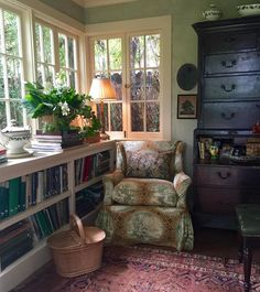 English-style library with beautiful old Clarence House toile on reading chair - Stamps & Stamps