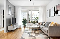 Elevate the living room with multiple storage and sofa pegs. Scandi Living Room, Open Plan Kitchen Living Room, Living Room Grey, Small Living Rooms, Home And Living, Living Room Elevation, Small Open Plan Kitchens, Rectangular Living Rooms, Interior Room Decoration