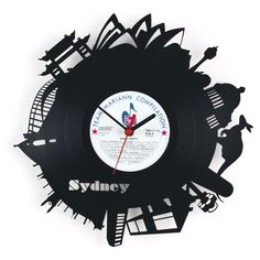 """Vinyl Wall #Clock made out of a real 12"""" #Acrylic Disc Record - Unique laser cut of silhouettes of #Sydney -- www.vintagist.com"""