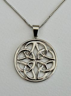 Celtic knot pagan pendant necklace, silver coloured on a chain. Gothic jewellery