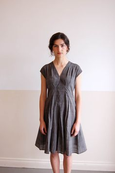 una: adri gray dress —  what I'm looking at is the way this dress is draped and the pin-tucked gathers in interesting spots.