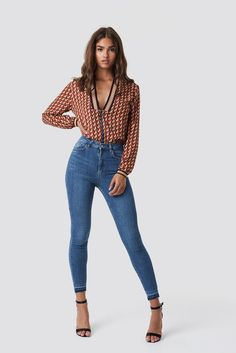 Denim is an evergreen trend! If you look for new outfit ideas, combine blue jeans with a silky blouse and high heels. It will give you a flawless look for any occasion.