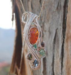 Fire Opal, Fire Agate,  Moldavite, emerald, tourmaline Heady wire wrap// crystal wrap// baller. $900.00, via Etsy.