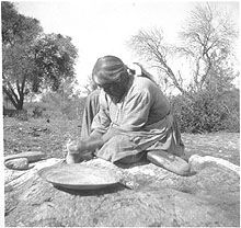 California Indian grinding acorns
