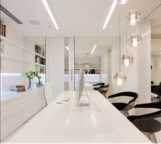 Robert Mills Architecture, Melbourne. Bpm Head office- The objective was to forge a link between a sophisticated commercial interior space and a warm residential environment within the office