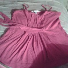 Pink American Eagle tie back Tank Good condition Size Large. Flowy bottom...a really pretty tank to wear with a pair of tight jeans or leggings. American Eagle Outfitters Tops Tank Tops
