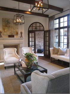 fireplace, fixtures, chairs- love the windows and comfy casual classy furniture pieces