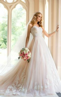 Perfect Princess: Stella York Style 5911. This Tulle and Lace dress includes scalloped Lace edging along the neckline. #SoStella #WeddingDress