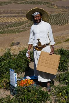 Collecting produce in the remote Haraz mountains of Yemen