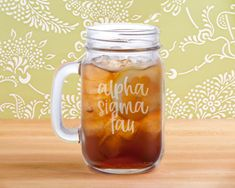 16 oz. drinking mason jar with handle. Design is laser engraved. Recommend hand wash only. Mason Jars With Handles, Sorority Big Little, Sorority Crafts, Hand Washing, Laser Engraving, Drinkware, Drinking, Mugs, Tableware