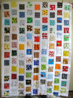 i spy quilt top, via Flickr. Great use of scraps!