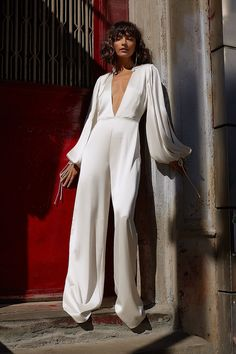 V-neck bridal jumpsuit with long sleeves **Check out THE DRESS TRIBE to see amazing dresses and find out which boutique stocks them! Party Dresses For Women, Bridal Dresses, Beautiful Dresses, Nice Dresses, Amazing Dresses, Dashiki Dress, Wedding Jumpsuit, White Bridal, Custom Dresses
