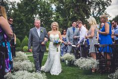 Gorgeous bride Courtney walks down an aisle crowned with baby's breath at The Calgary Zoo :)