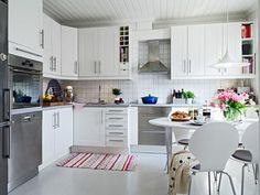white kitchen cabinets with long silver hardware - Google Search