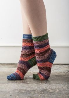 There are endless possibilities for these socks, you can choose to knit any combination of the four charts and add in plain stripes if you wish. You can make your socks match each other or just be close friends, make your colour sequence the same for both socks or mix it up!These socks are worked from the cuff down with a short row heel.Photographed socks shown in The Knitting Goddess Merino and Nylon Sock Take 5 yarn. For suitable alternative, please see below.